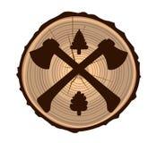 Dos hachas en la textura de madera Fotos de archivo libres de regalías