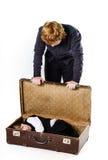 Dos hermanos que juegan con la maleta retra Imagen de archivo libre de regalías