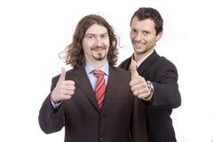 Dos hombres de negocios acertados con el pulgar para arriba Fotografía de archivo