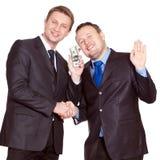 Dos hombres de negocios tienen un reparto imagen de archivo libre de regalías