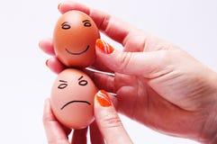 Dos huevos en manos Fotos de archivo