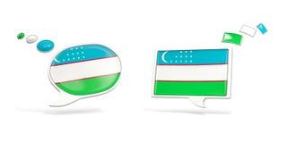 Dos iconos de la charla con la bandera de Uzbekistán Fotografía de archivo