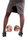 Dos individuos del empollón que miran un 'strip-tease' Imagen de archivo