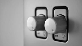 Dos interruptores más oscuros para las luces Imagen de archivo libre de regalías