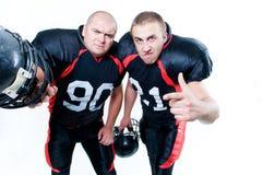 Dos jugadores de fútbol americano fotografía de archivo libre de regalías