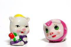 Dos juguetes del cerdo Fotos de archivo libres de regalías
