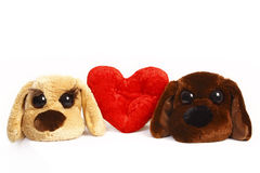Dos juguetes del perro y un corazón Imagen de archivo libre de regalías