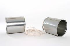 Dos latas y una cadena llama por teléfono Imágenes de archivo libres de regalías