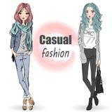 Dos lindos, moda, muchachas de la historieta Foto de archivo