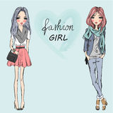 Dos lindos, moda, muchachas de la historieta Imagen de archivo