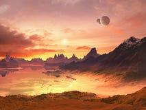 Dos lunas sobre la puesta del sol extranjera del océano Imagen de archivo libre de regalías
