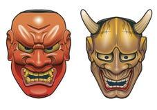 Dos máscaras japonesas tradicionales del teatro hechas de la madera en el fondo blanco Fotografía de archivo