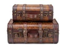 Dos maletas viejas apiladas Imagen de archivo libre de regalías