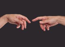 Dos manos alrededor a tocar Foto de archivo