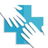 Dos manos con la cruz azul Foto de archivo libre de regalías
