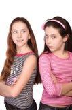 Dos manos de los adolescentes cruzadas aisladas en blanco Imágenes de archivo libres de regalías