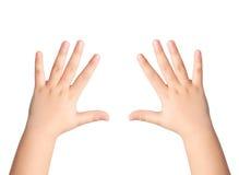 Dos manos de los niños en un fondo aislado Foto de archivo