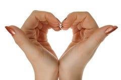 Dos manos forman una dimensión de una variable del corazón fotos de archivo