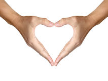 Dos manos hacen dimensión de una variable del corazón en blanco Foto de archivo