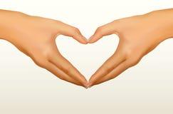 Dos manos hechas bajo la forma de corazón. Vector Fotos de archivo libres de regalías