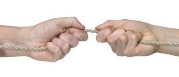Dos manos mientras que tracción de la cuerda Foto de archivo libre de regalías