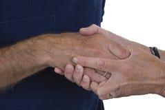 Dos manos que aprietan otras para la ayuda Fotos de archivo