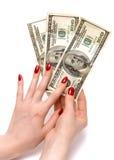 Dos manos que llevan a cabo dólares Foto de archivo