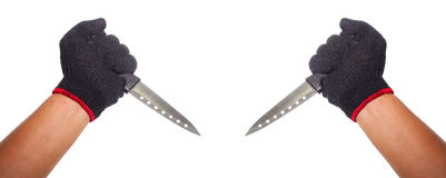 Dos manos que llevan a cabo los cuchillos lista para guisar o matanza Imagen de archivo libre de regalías