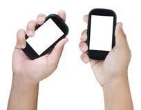 Dos manos que sostienen el teléfono elegante Imagen de archivo