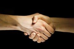 Dos manos unen con el eachother como acuerdo Foto de archivo