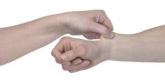 Dos manos y un pellizco Imagen de archivo