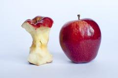 Dos manzanas con una mordedura Foto de archivo libre de regalías