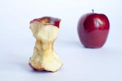Dos manzanas con una mordedura Imagenes de archivo