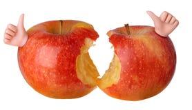 Dos manzanas rojas mordidas Fotos de archivo libres de regalías