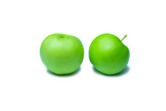 Dos manzanas verdes en el fondo blanco Imagenes de archivo