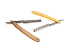 Dos maquinillas de afeitar oxidadas viejas aisladas Imágenes de archivo libres de regalías