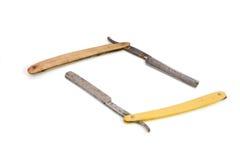 Dos maquinillas de afeitar oxidadas viejas aisladas Fotografía de archivo