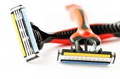 Dos maquinillas de afeitar que afeitan Ciérrese encima de imagen Foto de archivo