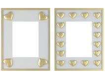 Dos marcos blancos con los corazones del oro Imagen de archivo libre de regalías
