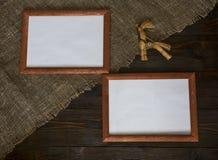 Dos marcos con un juguete Imagen de archivo libre de regalías