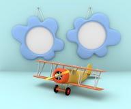 Dos marcos de la foto y aeroplano viejo en un fondo azul Imagen de archivo