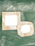 Dos marcos pintados sucios de la cartulina de la tiza en blanco en la pizarra Fotografía de archivo libre de regalías