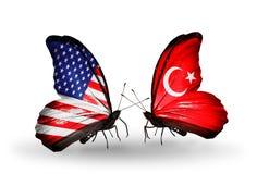 Dos mariposas con las banderas en las alas Foto de archivo libre de regalías