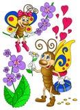 Dos mariposas felices entre las plantas Foto de archivo libre de regalías