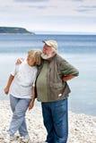 Dos mayores en la playa Imagen de archivo libre de regalías