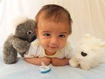 Dos meses de bebé con el juguete de la koala Imágenes de archivo libres de regalías