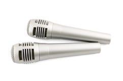 Dos microhones aislados en blanco Foto de archivo
