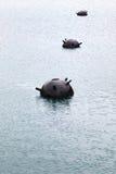 Dos minas subacuáticas en superficie del agua imágenes de archivo libres de regalías