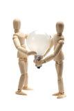Dos muñecas que sostienen una bombilla imagen de archivo libre de regalías