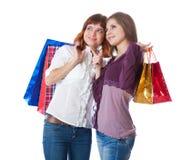 Dos muchachas adolescentes con los bolsos Imagen de archivo